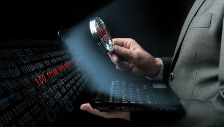 Businessman searching virus